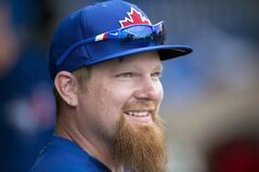Toronto Blue Jays' Adam Lind smiles on the bench during spring training action in Clearwater, Fla. on Wednesday February 26, 2014. The Toronto Blue Jays have activated first baseman Adam Lind from the 15-day disabled list. THE CANADIAN PRESS/Frank Gunn