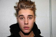 FILE - This Jan. 23, 2014 file photo made available by the Miami Beach Police Dept., shows Justin Bieber at the police station in Miami Beach, Fla. Ontario Provincial Police said Bieber, 20, was arrested Friday and charged with dangerous driving and assault following a collision between a minivan and an ATV in a rural area northeast of Bieber's hometown of Stratford. THE CANADIAN PRESS/AP/Miami Beach Police Dept., File