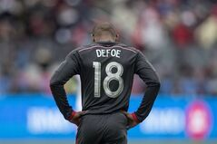 Toronto FC 's Jermain Defoe reacts to a missed goal scoring opportunity against D.C. United during first half MLS action in Toronto on March 22, 2014. Defoe says he is back to 100 per cent and ready to play this weekend after missing three Toronto FC games with a hamstring issue. And as for a role this summer with England at the World Cup, Defoe says he doesn't have to do a sales job on what he can do. He will let his football do the talking. THE CANADIAN PRESS/Chris Young