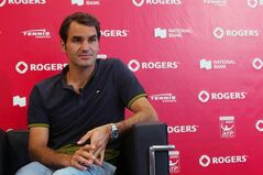 Roger Federer addresses the media during a news conference at the Rogers Cup tennis tournament in Toronto on Aug. 3, 2014. Federer is pretty relaxed. Who could blame him? At the age of 33, Federer has 17 Grand Slam titles and a family now four children deep after his wife gave birth to twin boys in May. THE CANADIAN PRESS/Victor Biro