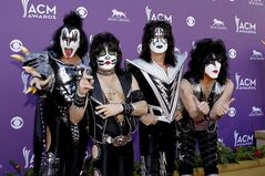 Gene Simmons, left to right, Eric Singer, Tommy Thayer and Paul Stanley, of the musical group KISS, arrive at the 47th Annual Academy of Country Music Awards in Las Vegas on April 1, 2012. When Kiss mainstays Paul Stanley and Gene Simmons helped found an Arena Football League franchise last August, the