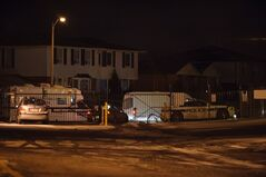 Police attend the scene of a shooting in Brampton, Ont. on Wednesday Jan. 23, 2013. Police in Ontario say a nine-year-old boy was sitting in his living room Wednesday night watching TV when he was fatally shot.THE CANADIAN PRESS/Victor Biro