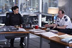 Officers Andy McNally (Missy Peregrym) and Oliver Shaw (Matt Gordon) in a scene from Season 5, Episode 2 of