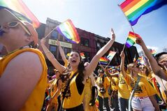 Paraders march during the 33rd annual Pride Parade in Toronto on June 30, 2013. THE CANADIAN PRESS/Michelle Siu
