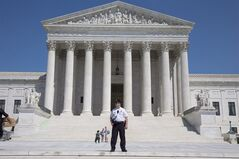 A Supreme Court Police officer stands outside the U.S. Supreme Court in Washington Saturday April 26, 2014. THE CANADIAN PRESS/AP, Jacquelyn Martin