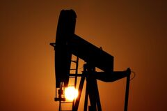 An oil pump works at sunset in the desert oil fields of Sakhir, Bahrain, Jan. 22, 2013. THE CANADIAN PRESS/AP, Hasan Jamali