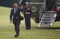 President Barack Obama waves as he steps off Marine One helicopter on the South Lawn at the White House in Washington, Thursday, July 10, 2014. THE CANADIAN PRESS/AP, Charles Dharapak