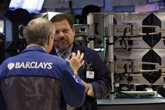 Traders confer on the floor of the New York Stock Exchange on July 8, 2014. THE CANADIAN PRESS/AP, Richard Drew