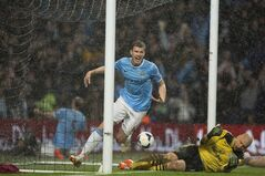 Manchester City's Edin Dzeko, centre, celebrates after scoring his first goal against Aston Villa during their English Premier League soccer match at the Etihad Stadium, in Manchester, England, on May 7, 2014. THE CANADIAN PRESS/AP, Jon Super