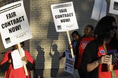 FILE - This Sept. 10, 2012 file photo shows Chicago teachers walk walking a picket line outside a school in Chicago, after they went on strike for the first time in 25 years. Chicago Mayor Rahm Emanuel has said if the Illinois Legislature _ which passed a historic measure last week to address the state's worst-in-the-nation public pension shortfall _ doesn't deal with Chicago's own multibillion-dollar pension problem next, city services could suffer in the future, with more teachers loosing their jobs. (AP Photo/M. Spencer Green, File)