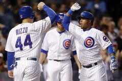 Chicago Cubs' Luis Valbuena, right, celebrates his three-run home run against the San Diego Padres with Anthony Rizzo, who scored, during the fourth inning of a baseball game on Wednesday, July 23, 2014, in Chicago. (AP Photo/Andrew A. Nelles)
