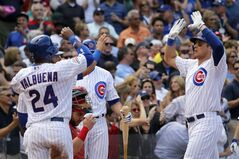 Chicago Cubs' Ryan Sweeney, right, celebrates his three-run home run off St. Louis Cardinals starting pitcher Joe Kelly with Luis Valbuena (24) during the second inning of a baseball game Friday, July 25, 2014, in Chicago. Valbuena and Welington Castillo also scored on the play. (AP Photo/Charles Rex Arbogast)
