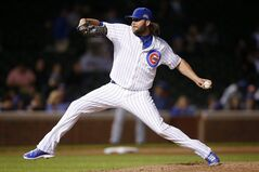 Chicago Cubs relief pitcher James Russell delivers against the San Diego Padres during the ninth inning of a baseball game on Wednesday, July 23, 2014, in Chicago. (AP Photo/Andrew A. Nelles)