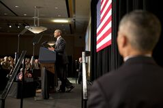 With Secret Service working in the foreground, President Barack Obama speaks at the League of Conservation Voters Capitol Dinner at the Ronald Reagan Building on Wednesday, June 25, 2014, in Washington. (AP Photo/Jacquelyn Martin)