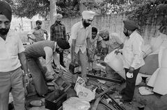 FILE - In this Nov. 6, 1984 file photo, members of the Indian Sikh community, whose house were attacked, burned and looted by mobs of Hindus, collect their looted property at a police station in New Delhi, India. India has blocked the release of a film on the assassination of former Indian Prime Minister Indira Gandhi, saying it glorifies her killers and could trigger violent protests, officials said Friday, Aug. 22, 2014. India's film certification board said the film glorified the two Sikh bodyguards who killed Gandhi to avenge her suppression of an insurgency that culminated in an army assault on the Golden Temple, Sikhism's holiest shrine. (AP Photo/Peter Kemp, File)