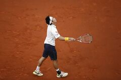 Kei Nishikori from Japan reacts during the Madrid Open tennis tournament men's final match against Rafael Nadal in Madrid, Spain, Sunday, May 11, 2014 . (AP Photo/Daniel Ochoa de Olza)