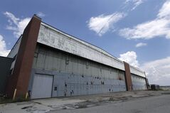 FILE - In this July 17, 2013, file photo is part of the former Willow Run Bomber Plant at Willow Run Airport in Ypsilanti Township, Mich. A group trying to save the Detroit-area factory where Rosie the Riveter became an icon of American female empowerment during the war said Monday, June 23, 2014, that it signed a purchase agreement for the property. (AP Photo/Paul Sancya, File)