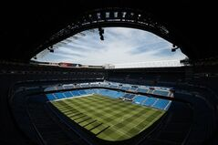 In this picture taken on May 18, 2014, Real Madrid's Santiago Bernabeu stadium is pictured in Madrid, Spain. The European Union is investigating whether government loan guarantees for seven soccer clubs violate EU competition law, designed in part to prevent businesses from enjoying unfair advantage through state intervention. The probe is examining tax breaks granted to the Real Madrid, Barcelona, Athletic Bilbao and Osasuna soccer clubs _ but that's a small part of government assistance to Spain's soccer league, according to the AP review. (AP Photo/Daniel Ochoa de Olza)