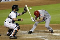 Cincinnati Reds' Ryan Ludwick (48) ducks to avoid a pitch by Miami Marlins' starting pitcher Jarred Cosart (23) in the fourth inning of a baseball game in Miami, Friday, Aug. 1, 2014. The Reds won 5-2. (AP Photo/Alan Diaz)