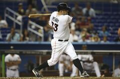 Miami Marlins' Brad Penny hits a double during the third inning of a baseball game in Miami against the Arizona Diamondbacks, Thursday, Aug. 14, 2014. (AP Photo/J Pat Carter)