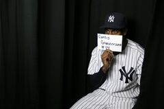 New York Yankees center fielder Curtis Granderson poses in a photo booth during the team's photo day at baseball spring training, Wednesday, Feb. 20, 2013, in Tampa, Fla. (AP Photo/Matt Slocum)