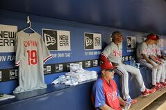 The uniform of Philadelphia Phillies' Tony Gwynn Jr. hangs in the dugout before the start a baseball game between Philadelphia and the Atlanta Braves, Wednesday, June 18, 2014, in Atlanta. The Phillies placed Gwynn on the bereavement list after his father, Hall of Famer Tony Gwynn, died of cancer on Monday. He was 54. (AP Photo/David Goldman)
