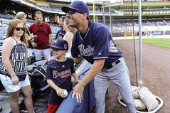 San Diego Padres' Jeff Francoeur poses with Parker Davis, 7, of Advance, N.C., before the Padres' baseball game against the Atlanta Braves, Saturday, July 26, 2014, in Atlanta. Francoeur is a former Braves player. (AP Photo/John Amis)