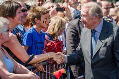 Belgium's King Albert II greets the public during the last day of his 3-day farewell tour in Liege, Belgium, on Friday July 19, 2013. In a fractious nation ever more divided by language, it may be too much to ask for a royal to hold it all together. Belgian King Albert on Sunday hands over the throne to his son Philippe in a day-long ceremony, but the transition from a trusted monarch to a disputed successor gives Belgians yet another subject to disagree on. (AP Photo/Geert Vanden Wijngaert)