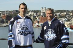 IceCaps president Danny Williams (left) and right-winger Jason King debut the team's jerseys. The parent-club Jets play the Senators today in St. John's.
