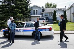 Calgary police investigators check out the home where five-year-old Nathan O'Brien and his grandparents Alvin and Kathryn Liknes disappeared, in Calgary, Alta., Wednesday, July 2, 2014. THE CANADIAN PRESS/Jeff McIntosh
