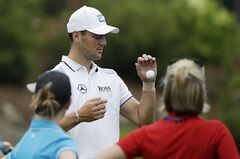 Martin Kaymer, of Germany, tosses his ball in the air on the 13th tee during a practice round for the PGA Championship golf tournament at Valhalla Golf Club on Tuesday, Aug. 5, 2014, in Louisville, Ky. The tournament is set to begin on Thursday. (AP Photo/David J. Phillip)