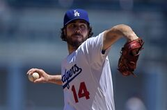 Los Angeles Dodgers starting pitcher Dan Haren throws to the plate during the first inning of a baseball game against the Milwaukee Brewers, Sunday, Aug. 17, 2014, in Los Angeles. (AP Photo/Mark J. Terrill)