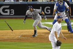 San Diego Padres' Rene Rivera heads to first on an RBI single, as Los Angeles Dodgers starting pitcher Clayton Kershaw, center, and catcher A.J. Ellis watch the ball during the seventh inning of a baseball game, Thursday, Aug. 21, 2014, in Los Angeles. (AP Photo/Mark J. Terrill)