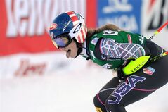 Mikaela Shiffrin of the United States celebrates her third place in an alpine ski, women's World Cup giant slalom, in Lienz, Austria, Saturday, Dec. 28, 2013. (AP Photo/Marco Tacca)