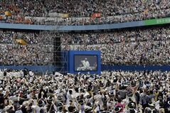 Pope Francis is seen on a huge screen upon Pope's arrival for the Mass of Assumption of Mary at Daejeon World Cup stadium in Daejeon, south of Seoul, South Korea, Friday, Aug. 15, 2014. (AP Photo/Lee Jin-man,Pool)
