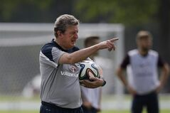 England national soccer team head coach Roy Hodgson points during a squad training session for the 2014 soccer World Cup at the Urca military base in Rio de Janeiro, Brazil, Saturday, June 21, 2014. Costa Rica's surprise 1-0 win over Italy on Friday meant that England made its most humiliating exit from a World Cup since 1958, following consecutive defeats by the Italians and then Uruguay in Group D. England play Costa Rica in their final Group D match on Tuesday. (AP Photo/Matt Dunham)