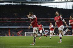 Arsenal's Santi Cazorla, left, celebrates scoring his side's first goal with Olivier Giroud, 12, during the English Premier League soccer match between Arsenal and Fulham at the Emirates Stadium in London, Saturday, Jan. 18, 2014. (AP Photo/Matt Dunham)