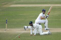 England captain Alastair Cook hits a shot past India's Cheteshwar Pujara during the fourth day of the third cricket Test match of the series between England and India at The Ageas Bowl in Southampton, England, Wednesday, July 30, 2014. (AP Photo/Matt Dunham)