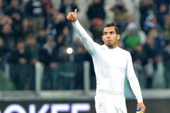 FILE - In this Wednesday, March 26, 2014 file photo, Juventus forward Carlos Tevez, of Argentina, celebrates at the end of a Serie A soccer match between Juventus and Parma at the Juventus stadium, in Turin, Italy. The lawyer for Carlos Tevez said the father of the Argentina and Juventus star was kidnapped on Tuesday, July 29, 2014, but was released eight hours later and appeared to be physically unharmed. Lawyer Gustavo Galasso said the forward's father was