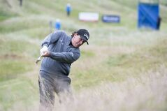 U.S. golfer Phil Mickelson plays from the rough on the 4th hole during day one of the Scottish Open at Royal Aberdeen golf course, Aberdeen Scotland Thursday July 10, 2014. (AP Photo/Kenny Smith/PA) UNITED KINGDOM OUT NO SALES NO ARCHIVE