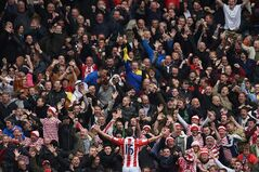 Stoke City's Charlie Adam celebrates his goal during their English Premier League match at The Hawthorns, West Bromwich, England, Sunday, May 11, 2014. (AP Photo/Joe Giddens, PA Wire) UNITED KINGDOM - NO SALES - NO ARCHIVES