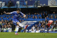 Chelsea's Oscar scores against Stoke City during their English FA Cup fourth round soccer match at Stamford Bridge, London, Sunday, Jan. 26, 2014. (AP Photo/Sang Tan)