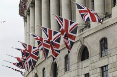 An office building by the river Thames in London is decorated with British flags in preparations for the weekend celebrations to mark the Diamond Jubilee of Queen Elizabeth II Thursday, May 31, 2012. The capital is preparing to celebrate the Diamond Jubilee, the 60th anniversary of the accession of Queen Elizabeth II to the throne. (AP Photo/Sang Tan)