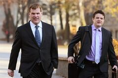 Foreign Minister John Baird arrives with an aid at Queen's University in Kingston, Ont., on Wednesday Nov. 21, 2012, to attend the honorary degree ceremony for former U.S. President Jimmy Carter. Foreign Affairs Minister John Baird says he's cautiously optimistic about the ceasefire now in effect between Israel and Hamas. THE CANADIAN PRESS/Lars Hagberg