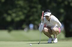 Sandra Gal of Germany lines her putt on the ninth hole during the first round of the Meijer LPGA Classic golf tournament at Blythefield Country Club, Thursday, Aug. 7, 2014 in Belmont, Mich. (AP Photo/Carlos Osorio)