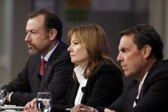 General Motors President Dan Ammann, left, CEO Mary Barra, and Executive Vice President Mark Reuss, hold a news conference at the General Motors Technical Center in Warren, Mich., Thursday, June 5, 2014. Barra said 15 employees — many of them senior legal and engineering executives — have been forced out of the company for failing to disclose a defect with ignition switches, which the company links to 13 deaths. Five other employees have been disciplined. (AP Photo/Carlos Osorio)