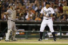Colorado Rockies catcher Michael McKenry signals for a base on balls to Detroit Tigers' Miguel Cabrera during the fifth inning of an interleague baseball game, Saturday, Aug. 2, 2014, in Detroit. (AP Photo/Carlos Osorio)