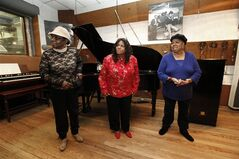 This March 12, 2013 photo shows The Andantes, from left, Jackie Hicks, Louvain Demps, and Marlene Barrow-Tate during a visit to in Hitsville USA's Studio A at the Motown Historical Museum in Detroit. In their 70s, the unsung backing group who sang on thousands of Motown songs is finally getting acclaim for its contributions to the ground-breaking, chart-topping music made in Detroit in the 1960s and early '70s before the label moved to Los Angeles. (AP Photo/Paul Sancya)