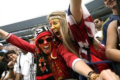 Soccer fans cheer during a Guinness International Champions Cup soccer match between Manchester United and Real Madrid at Michigan Stadium in Ann Arbor, Mich., Saturday, Aug. 2, 2014. (AP Photo/Paul Sancya)