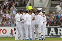 England's James Anderson, centre, celebrates with teammates after taking the wicket of India's Virat Kohli for 0 at Old Trafford cricket ground on the first day of the fourth test match of their five match series, in Manchester, England, Thursday, Aug. 7, 2014. (AP Photo/Jon Super)